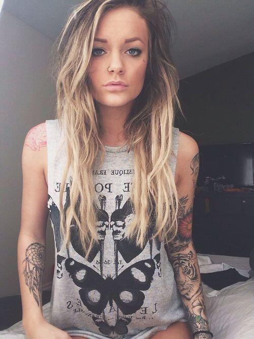 girl tattooed blonde muscle tank grey ink pretty streaked
