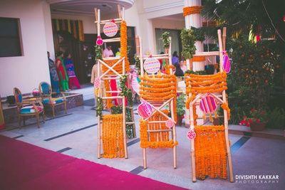 genda phool decor, floral decor, floral ladder, genda phool ladder