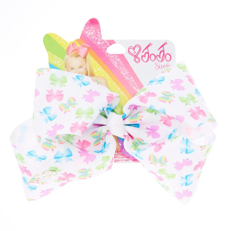 "<!-- mp_trans_remove_start=""FR"" --><P>For the ultimate Jojo fan this new style bow is perfect! The classic JoJo look takes a super fun twist with an all over bow print design. This large white bow from the JoJo Siwa collection features an all over multi-coloured bow print and has been attached to a metal salon clip making it really easy to wear.</P> - <UL> - <LI>JoJo Siwa collection</LI> - <LI>Large multi-coloured bow<&#x2F..."