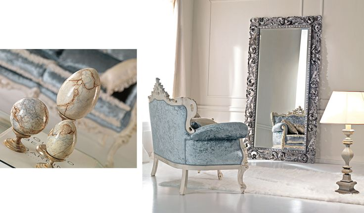 Carved mirror frame decorated with silver.