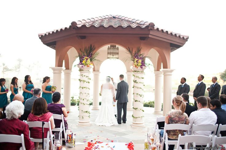 Enchanted Florist Las Vegas- Ceremony Decor- Arch accents with garland around pillars.