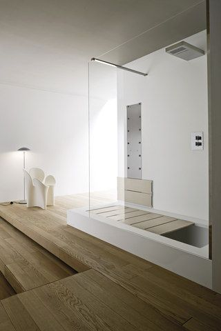 full sized shower that converts into a full sized sunken tub with a reading platform.