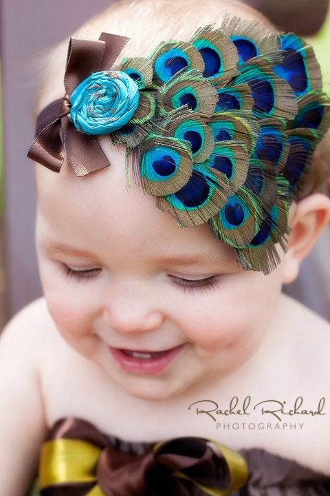 peacock feather headband with silk dupioni rolled flower and bow for baby toddler or big girls you choose color of headband. $21.00, via Etsy.