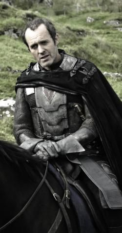 Stannis Baratheon is the elder of Robert's younger brothers and claims to be the Kingdom's rightful heir. However, it is difficult for him to gain support because he is not widely liked. While at Dragonstone, he became influenced by Melisandre, a red priestess of R'hollor, who claims to see things in her flames. Ramsay Bolton sent out a raven that Stannis is dead, but he actually overtook Deepwood Motte and keeps Asha & Theon as prisoners. He has a wife, Selyse, and a daughter, Shireen.