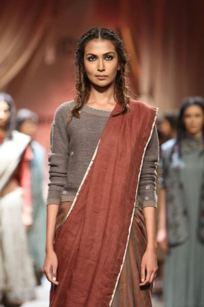 Anavila Misra's collection Anavila was unveiled on day 3 of Amazon India Fashion Week Autumn/Winter 2016. The collection was distinguished by elegant drapes and a colour palette of brown, red, yellow and grey, which brought a truly modern look to Misra's range of lehengas and sarees.
