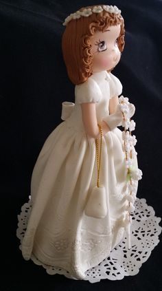 Stunning First Communion Girl holding a flower rosary with a little purse place on her left arm also has elegant details in White Gown or Elegant Boy with a bible placed on his hands This beautifully