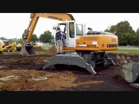 Liebherr 900 wheel excavator with attachments - YouTube