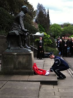 """EDINBURGH, Scotland—Staff Sgt. Aaron Campbell, 48th Fighter Wing Honor Guard team leader lays a wreath during the 79th Scottish American Memorial Day Service May 27, 2013. The ceremony takes place in front of """"The Call"""" war monument, which was funded by Scots-Americans in 1927 to commemorate the Scotsmen who lost their lives during World War I. (U.S. Air Force photo by 1st Lt. Lyndsey Horn)"""