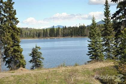 It does not get any better. This is the chance to own a 19 acre lake frontage in a very desirable area.Complete privacy and glacier views!  Enjoy building your own lifestyle gem in one of the most be