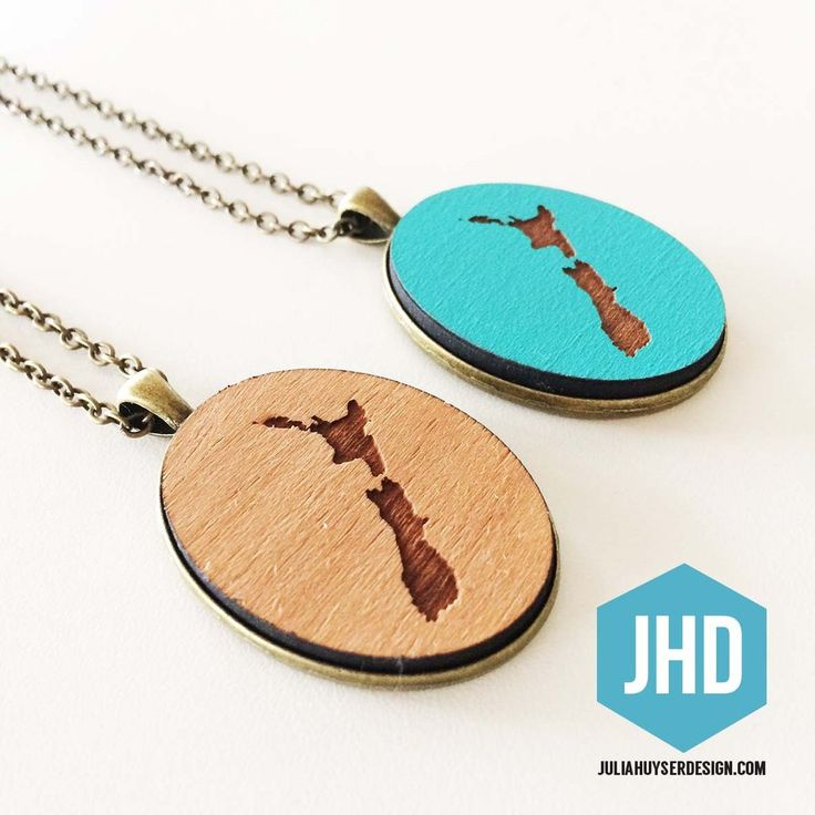Pendants are perfect for dress or casual.   Adjustable 80cm length chain to suit any neckline. 30 x 40 mm wooden oval face. Hand-made. Hand-painted in Resene paints. Special NZ map engraved into the wood. Bronze backing. Nickel and Lead Free.