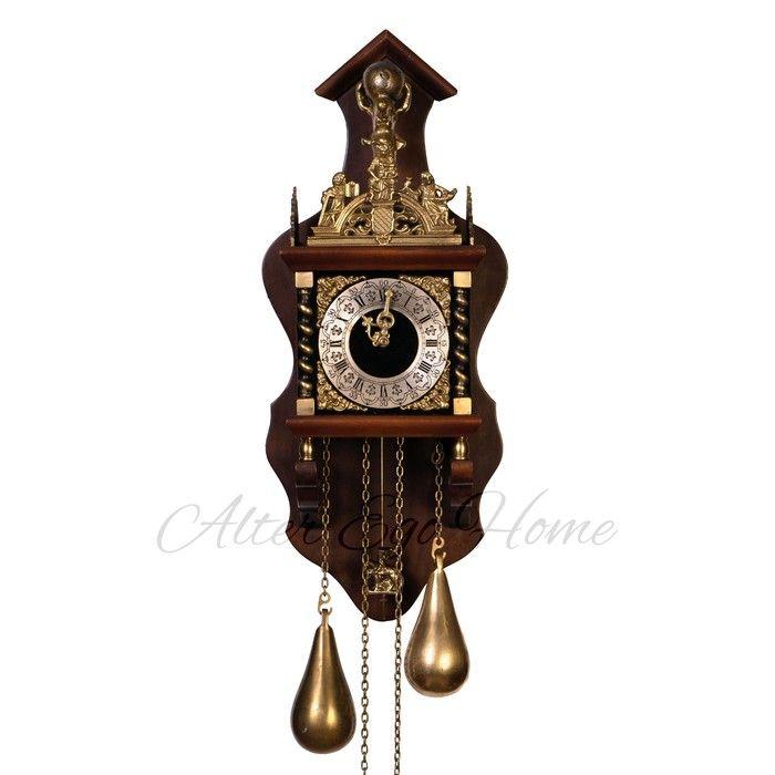 Настенные часы с обильной латунной чеканкой