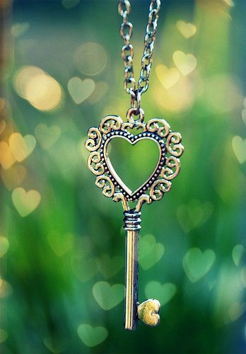key to my heart - key on necklace chain with green background with tiny hearts floating - iphone wallpaper background lock screen