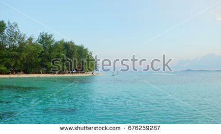 Beautiful morning at karimunjawa, java island, indonesia. Golden sunrise around the beach at south east asia. The beautiful view of tropical paradise.