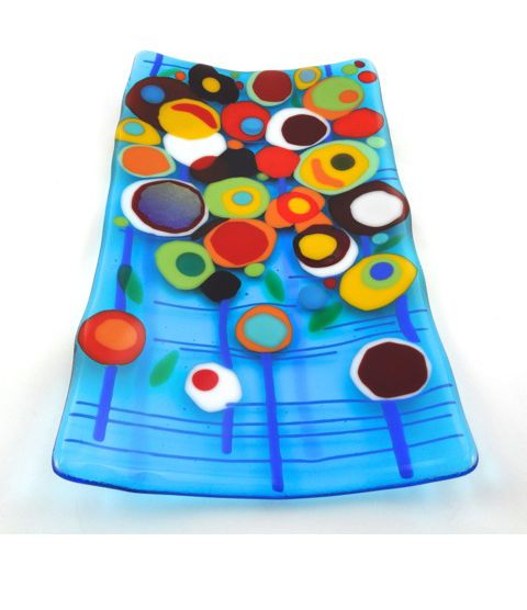 Layer lots of fused glass circles to create a surreal flower garden effect!