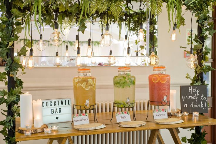 Rustic table bar with filament festoon drops and artificial foliage by www.stressfreehire.com #venuetransformers - photo by Weddings at Silvermere