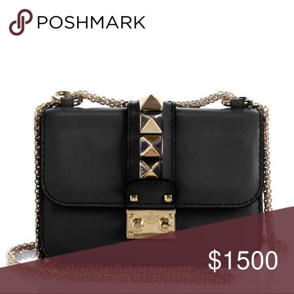 Valentino Garavani Rockstud Lock Mini Shoulder Bag A petite shoulder design in smooth leather with Valentino's radiant pyramids studs on top, all finished with an elegant chain strap. Valentino Garavani Bags Shoulder Bags