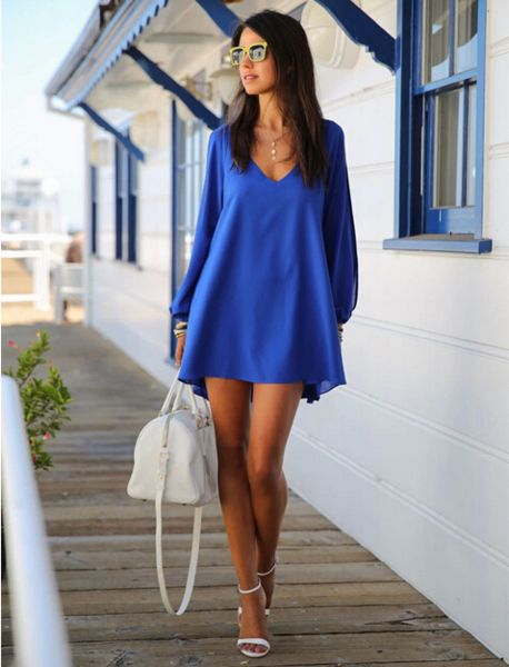 """This crisp Bikini Luxe """"Wanderlust"""" Blue Chiffon Dress is the perfect dress for Summer. The loose fit of this chiffon dress makes it ultra comfortable, and the long sleeves are slit down to the wrists, to give you a sophisticated look. The Wanderlust summer dress is light and airy, and is made of silky blue soft fabric. The V-neck front creates the perfect frame for a dainty necklace, or a statement piece. Luxe up your look with a gold chain belt.  #dress #summerdress #chiffondress"""