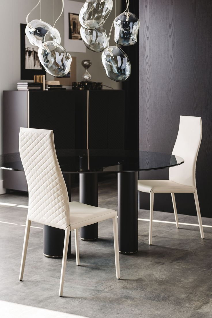 The Norma Couture dining chair is upholstered