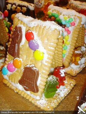 diy mini gingerbread house made with LU petit beurre or Leibniz biscuit cookies and gummy bears