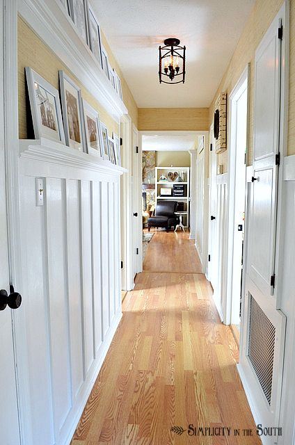 I love this style: Board-and-batten-hallway-with-gallery-shelves
