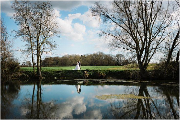 Suffolk Wedding Photography-Mark and Becky #granarybarn #granaryestates #pond #suffolkvenue #bluesky #brideandgroom #weddingphotos