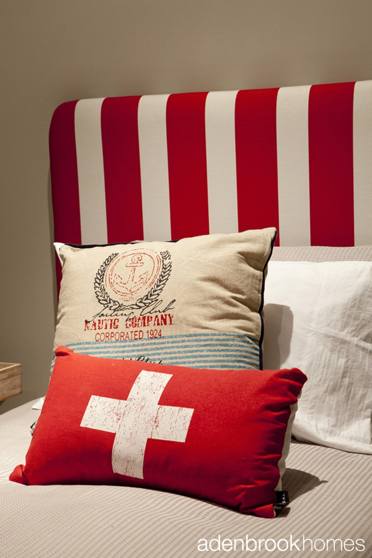 Cushion and pillow arrangement on child's bed