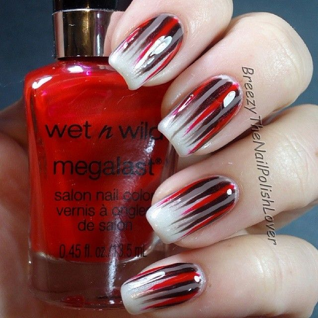Let your nails give a statement with this powerful Ombre nail art design.  Combine strong colors such as black, red and silver with frosted white tips  to ... - The 25+ Best Red Black Nails Ideas On Pinterest Halloween Nail