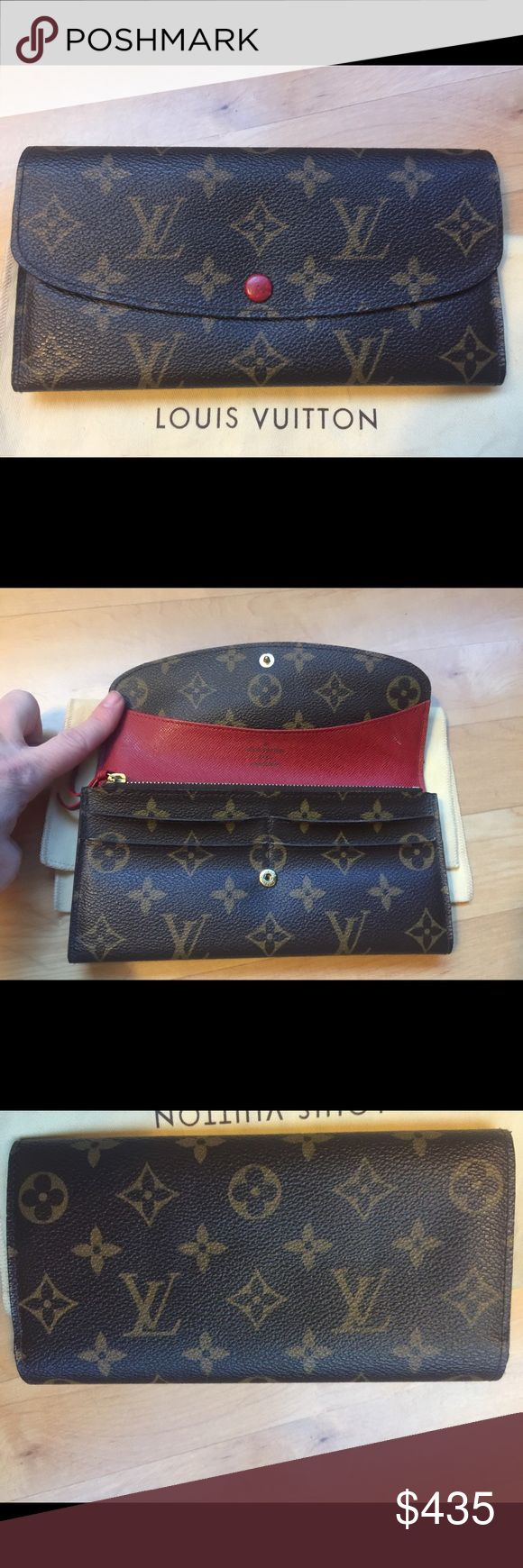 Louis Vuitton Emilie Wallet Authentic Louis Vuitton Emilie Wallet with red interior. 4 card slots zipped coin pouch,two bill compartments. Red button in front is just slightly marked up. Card slots are a touch bent as seen in photo. Made in Spain #CA0110. Purchased in Los Angeles. No trades Louis Vuitton Bags Wallets