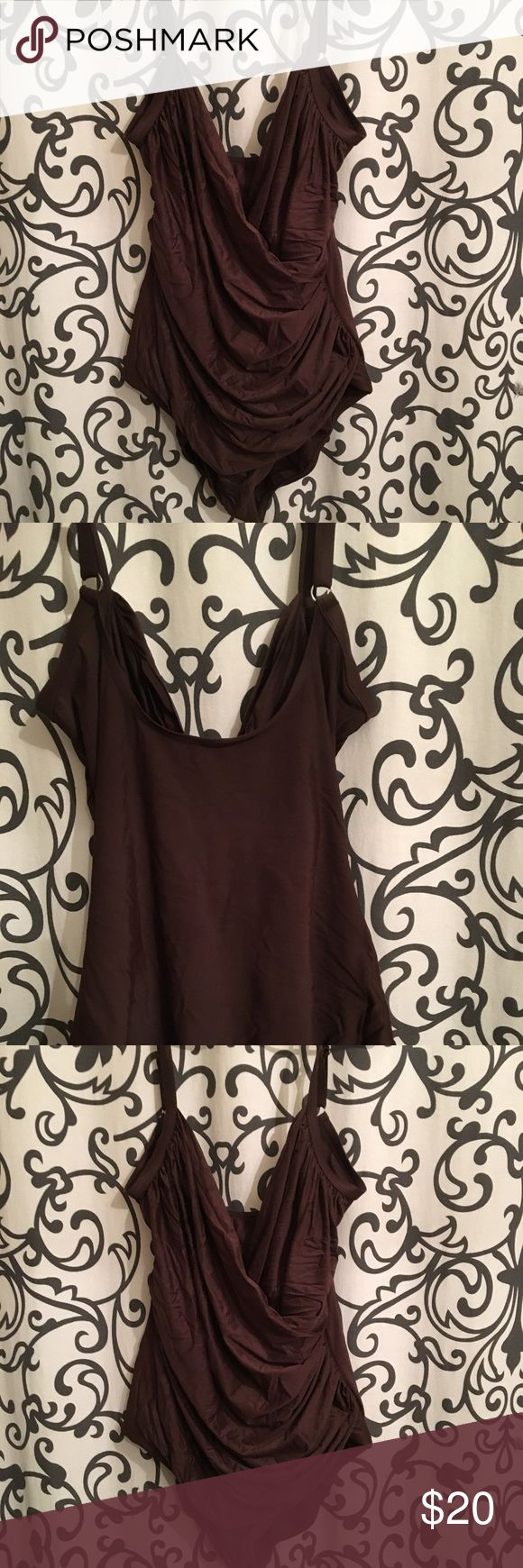 Brown one piece bathing suit 🏝🌺 This bathing suit gives a beautiful waist line I wish I could still wear it but it's big . It needs a new home I wash all clothes that I sell and this bathing suit is ready to go 🏝🌺 Catalina Swim One Pieces