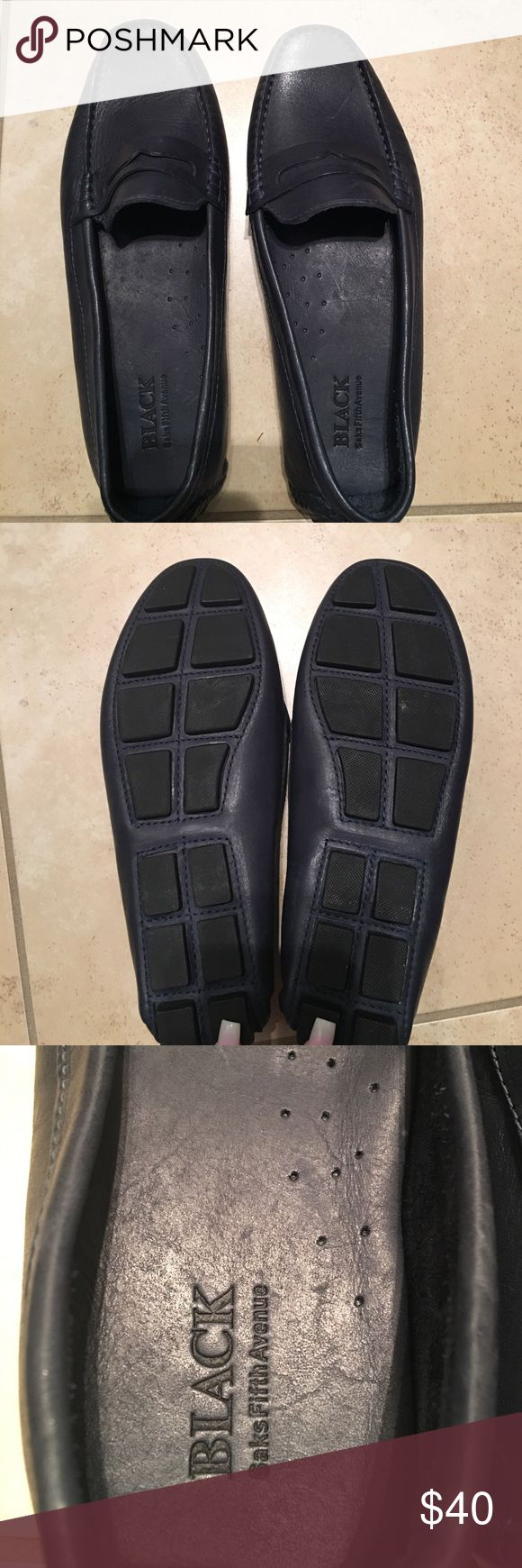 Ladies in navy blue loafers Ladies navy blue leather loafers. Black brand from Saks Fifth Avenue. Maybe worn once, like new condition. Black Saks Fifth Ave Shoes Flats & Loafers