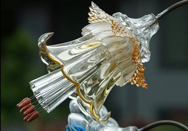 Incredible glass flowers designed and constructed using antique glass (vases, cups, saucers) by Mike Urban http://home.comcast.net/~macurban/flowers/index.html