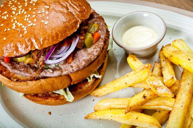 """Massive """"Klubovňa"""" burger fitted into two hands! With steak fries and baked garlic mayo."""