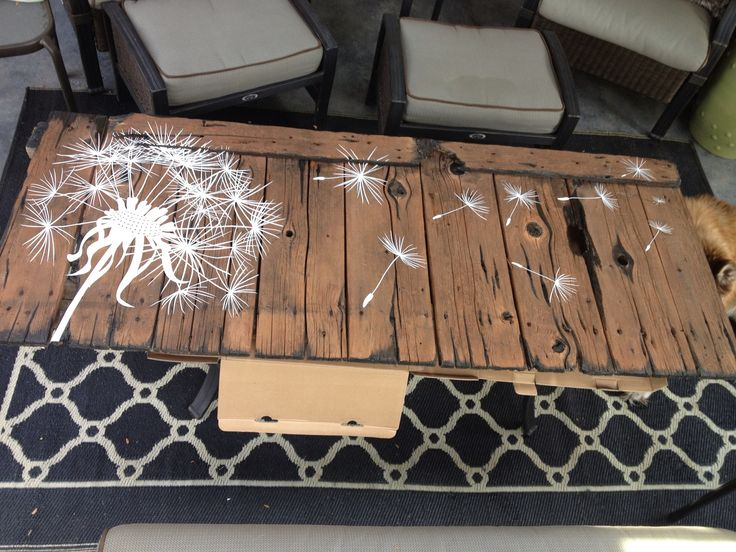 Barn Wood Project - My dad had a gray weathered piece of barn-wood next to his garage. I took black stain and accented the outer parts of the board and the knots. Next I stained the wood a dark walnut. Lastly, I added the dandelion decals - I am thinking it will be a great headboard...