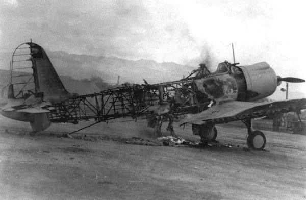A destroyed Vindicator at Ewa field the victim of one of the smaller attacks on the approach to Pearl Harbor.