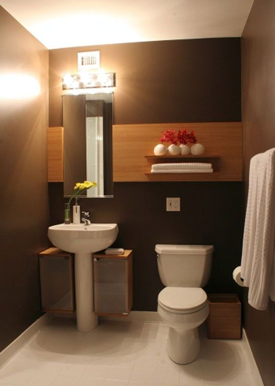 Pedestal sinks not only save space in a small bathroom, but they can also add visual interest