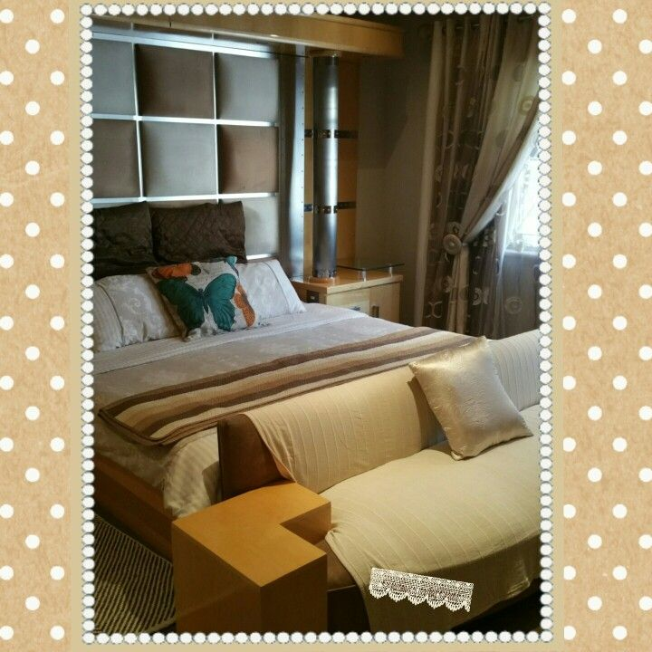 My bedroom, neutral colours and a colourful cushion to give a splash of colour.