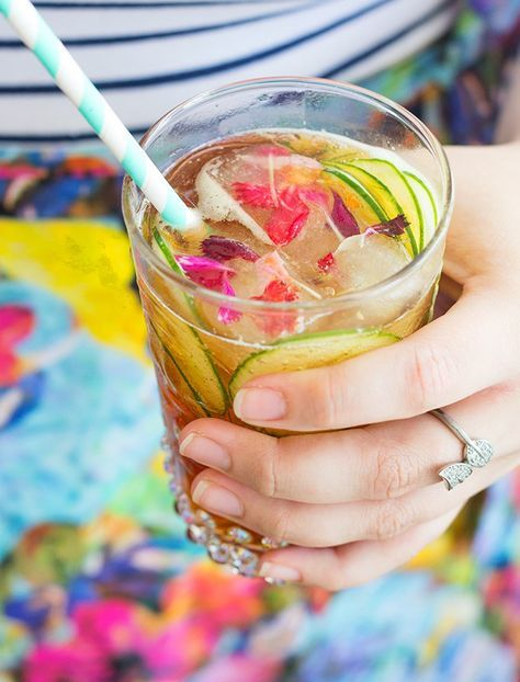 The Garden Party Cocktail. Pimms, gin, elderflower and pretty floral ice cubes! Read more on spicyicecream