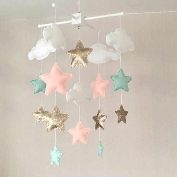 Clouds and stars baby crib mobile. An ideal gift for a new babys nursery or room decor in an older childs bedroom.  This mobile consists of five white