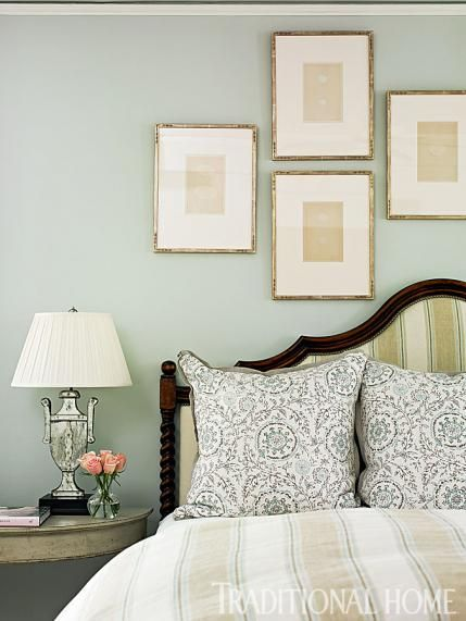 Antique Prints Hang Above The Bed In A Pleasing