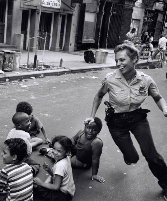 +~+~ Vintage Photograph ~+~+  Police Officer playing with children.  New York ca. 1970.