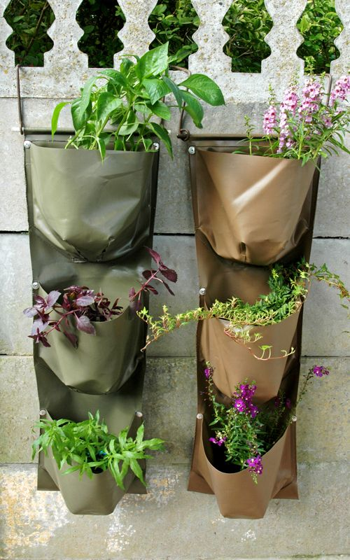 Vertical Gardens in Howard Green and Tan. Easily installed with brackets over your wall.