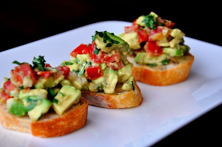#Appetizers Guacamole bruschetta 1 garlic  2 Tblsp olive oil  2 tomatoes  2 avocados  1/3 c onion  ¼ c cilantro  2 Tblsp lime juice  S  Oven 400º  Place sliced bread on baking sheet Toast 3¨ per side  Immediately rub with garlic Brush tops with oil  Combine chopped tomatoes avocado onion cilantro lime juice s