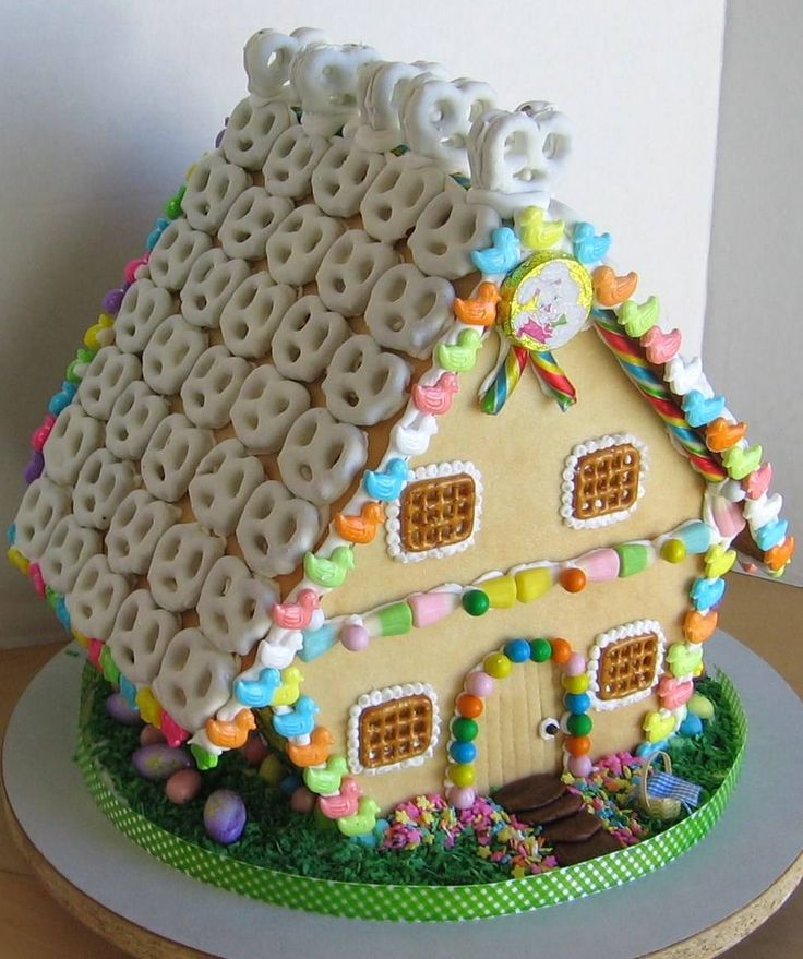 """""""2009 Easter Gingerbread House: Gingerbread houses aren't just for Christmas, although they're traditionally associated with that holiday. When decorated appropriately, they make wonderful centerpieces for Halloween, Thanksgiving, Valentine's Day, St. Patty's Day, Easter, bridal showers, baby showers, even weddings."""" House and photo by Barbara Rolek."""