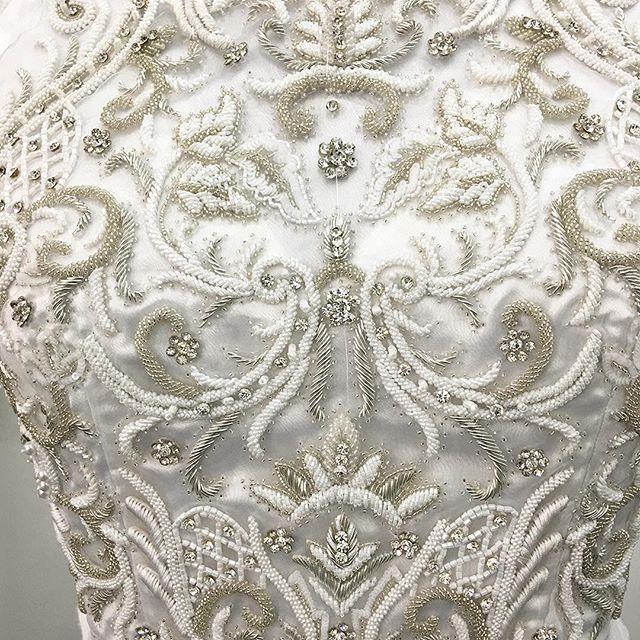 Close-up of the finished #bodice of the heavily #embellished #silver and #white #weddingdress #handembroidery #beading #symmetry #embroidery #design #artisan #madebyhand #artisanal #bridal #fashion #couture #wedding #gown #ethicallymade #craftsmanship #ethicalfashionforum