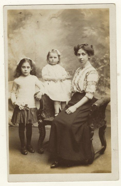This photo postcard was produced by Moore's Studio which was located in Camberwell, a district in South London, England.