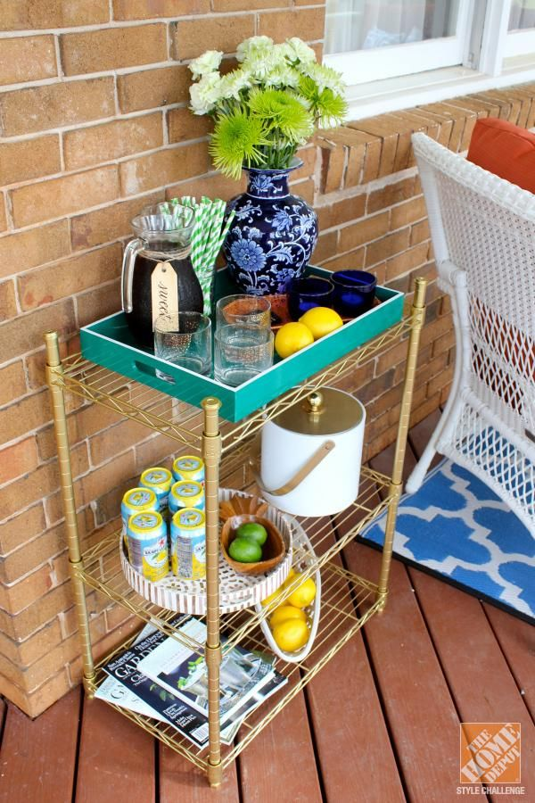 DIY Idea: A glamorous facelift for an ordinary shelving unit! All it took was some gold spray paint.
