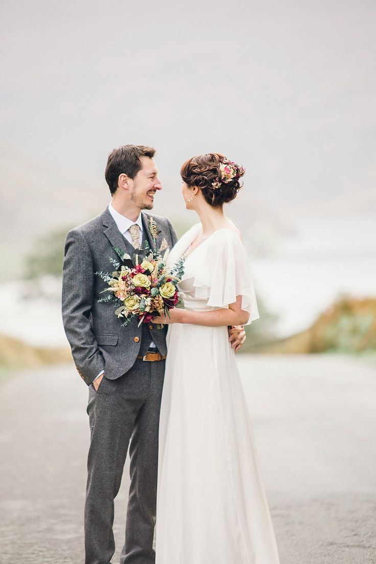 Lovely Lake District wedding where the groom wore a CatkinJane Liberty tie and pocket square, and the bride wore a Jenny Packham gown for her homemade, Autumn wedding. Photography by Jessica Reeve.
