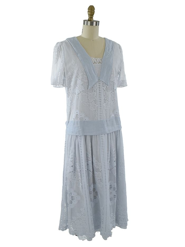 Pale blue lace vintage tea dress from the 1980s is a lovely, ladylike look for a 1920s garden or lawn party.  Add T straps shoes and cloche hat with flowers.