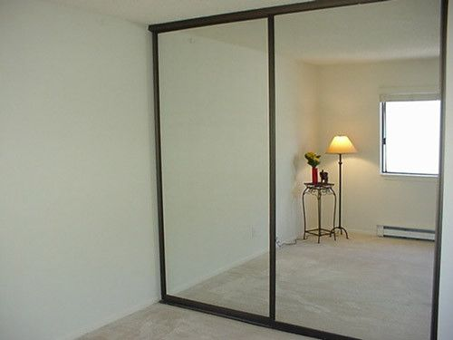 Cheap (potentially free) home gym mirrors - sliding closet doors with large vanity mirrors - Remove the frame...