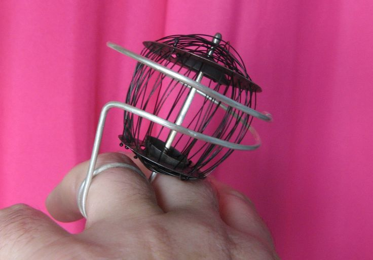 "here is my ""baby"" !! :-) Ismini Pachi - ""Childhood dreams or adult reality?"" collection - ""Lady in black"" ring -silver, steel,monofilament:"